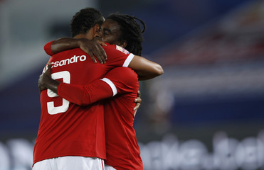 Alecsandro and Tinga of Brazil's Internacional celebrate a goal during their Club World Cup third place playoff soccer match against South Korea's Seongnam Ilhwa at Zayed Sports City in Abu Dhabi