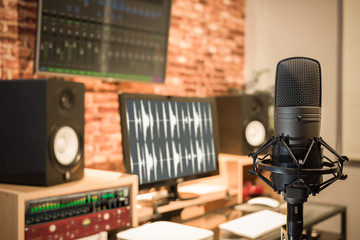 condenser microphone on digital recording studio background