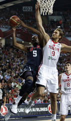 Durant of U.S. goes up to shoot against Turkey's Erden during their FIBA Basketball World Championship final game in Istanbul