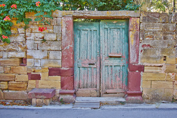 pale green door on vintage house stone wall facade