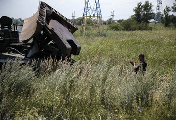 Sapper leads an armoured engineering vehicle as he checks the area around an Ukrainian army checkpoint just outside the eastern Ukrainian town of Slaviansk