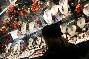 A shopper looks at jewellery for sale in New York City