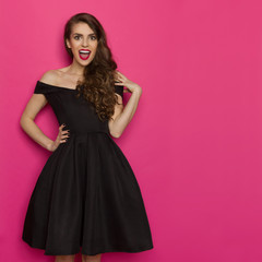 Excited Elegant Young Woman In Black Dress