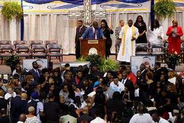 Friends and family attend the funeral of Alton Sterling, in Baton Rouge, Louisiana