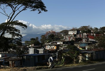 A man walks near low-income neighbourhood Triangulo de la Solidaridad, north of San Jose
