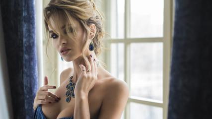 fashion woman portrait with jewelry on dark background