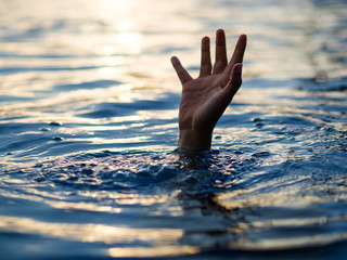 Drowning victims, Hand of drowning man needing help. Failure and rescue concept. Fototapete