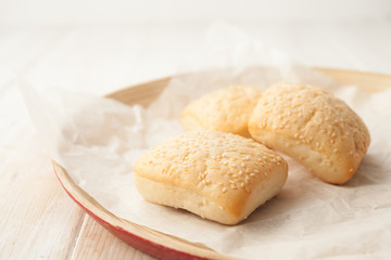 Cooked buns with sesame seeds on the baking paper