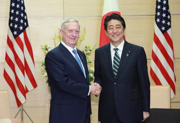 U.S. Defense Secretary Jim Mattis and Japanese Prime Minister Shinzo Abe shake hands at the prime minister's office in Tokyo