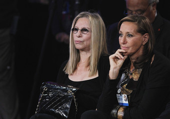 Singer Barbra Streisand and designer Donna Karan listen to a speaker during the final day of the Clinton Global Initiative 2012 in New York