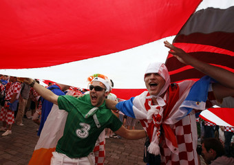 A Croatian and an Irish supporter cheer before the Euro 2012 soccer match between their teams in Poznan