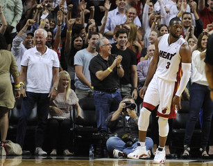 Miami Heat's Dwyane Wade reacts following his game winning shot against the Indiana Pacers during overtime of their NBA basketball game in Miami.