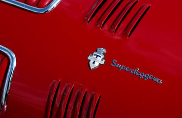 The logo of Italian coachbuilder Carrozzeria Touring is seen at an Alfa Romeo sports car is seen during race demonstration in Zurich's Oerlikon suburb