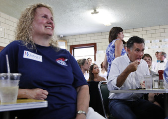 Republican U.S. presidential candidate Romney eats ice cream during campaign stop at Tom's Ice Cream Bowl in Zanesville