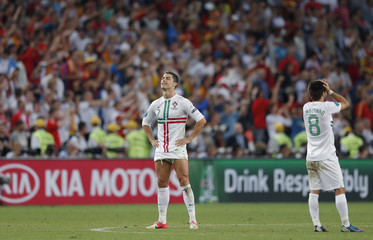 Portugal's Ronaldo and Moutinho react after loosing penalty shoot-out of the Euro 2012 semi-final soccer match against Spain at Donbass Arena in Donetsk