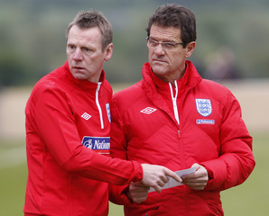 England's coach Capello and his assistant Pearce attend a pre-World Cup training session in Irdning