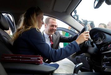 Russian Prime Minister Dmitry Medvedev and synchronized swimmer Natalia Ischenko take part in the awarding of new cars to Russian Olympic medallists returning home from the 2016 Rio Olympics in Moscow's Kremlin