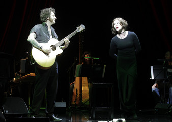 Actress Lyssewski and musician Riedel perform on stage during the piece 'Fool of Love' in Vienna