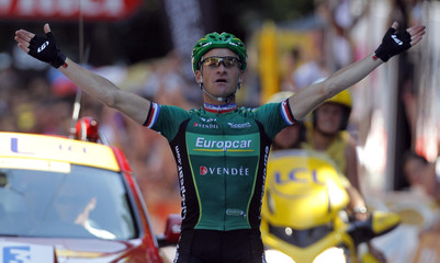 Team Europcar rider Voeckler of France holds up his arms as he wins the 16th stage of the 99th Tour de France cycling race between Pau and Bagneres-de-Luchon