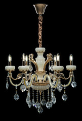 Contemporary bronze glass chandelier isolated on black background.