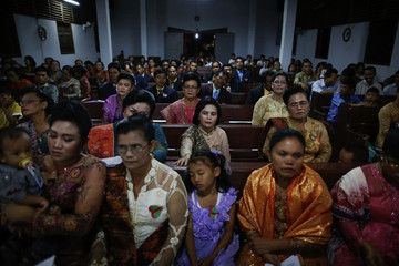 Acanese Protestants attend an early Christmas mass in their church in Banda Aceh
