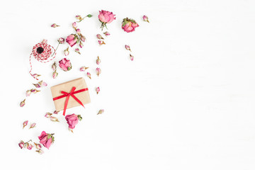 Flowers composition. Gift and dried rose flowers on white background. Flat lay, top view