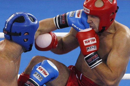 Tomasz Mordarski of Poland is punched by Parviz Abdullayev of Azerbaijan during their semi-final bout in the low-kick 71kg kickboxing competition at the Combat Games in Beijing