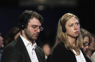 Chelsea Clinton and her husband Marc Mezvinsky listen to speakers discuss climate change at the Clinton Global Initiative in New York