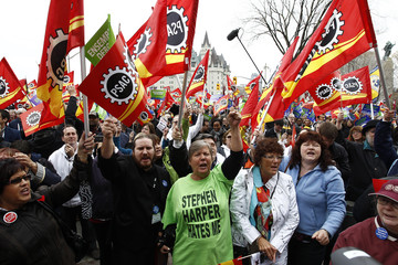 Demonstrators take part in a protest against federal austerity measures outside Langevin Block in Ottawa