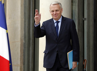 France's newly appointed Prime Minister Ayrault enters the Elysee Palace before the first meeting of his newly formed cabinet in Paris