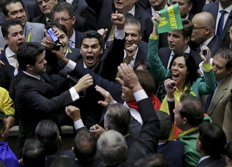 Members of the Lower House of Congress celebrate during the impeachment voting in Brasilia