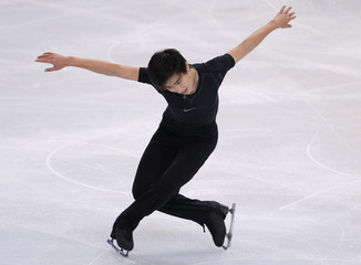 Song Nan of China practises his men's short program during a training session before the Bompard Trophy ISU Grand Prix of figure skating competition in Paris