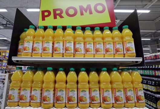 Casino's orange juice bottles are displayed in a Casino supermarket in Nice