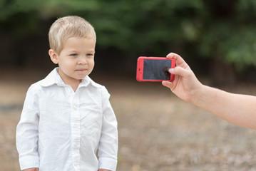 Young Boy Getting Photo Taken