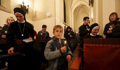Faithfuls attend the Holy Saturday service at a Roman Catholic church in Krasnoyarsk