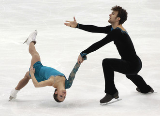 Duhamel and Radford of Canada perform during the pairs short program competition at the ISU Four Continents Figure Skating Championships in Taipei