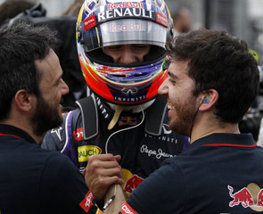 Red Bull Formula One driver Ricciardo of Australia celebrates finishing second fastest with teammates after the qualifying session for the Australian F1 Grand Prix in Melbourne