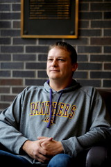 University of Northern Iowa student Happel sits for a portrait on the UNI campus in Cedar Falls