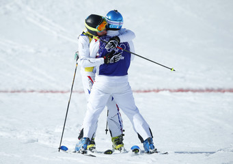 France's third placed Midol and compatriot second placed Bovolenta embrace after the men's freestyle skiing skicross final at the 2014 Sochi Winter Olympic Games in Rosa Khutor