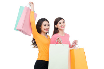 Two asian girl friends with shopping isolated on white