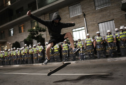 A demonstrator performs with his skateboard during a protest against the 2014 World Cup in Sao Paulo