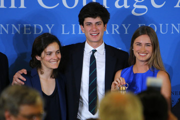 Rose and Jack Schlossberg, grandchildren of former U.S. President John  F. Kennedy, pose for a photograph with Lauren Bush Lauren, who accepted the 2014 Profile in Courage Award on behalf of her grandfather, former U.S. President George H. W. Bush, at the