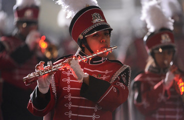 Marching band members attend the 2012 Hollywood Christmas Parade with lighted up instruments in Los Angeles