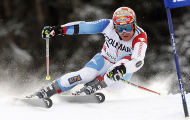 Cuche of Switzerland clears a gate during the first run in the men's giant slalom Alpine Skiing World Cup event in Alta Badia