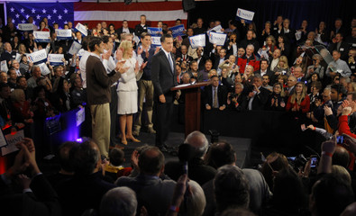 Republican presidential candidate and former Massachusetts Governor Mitt Romney is applauded as he speaks to supporters at his New Hampshire primary night rally in Manchester