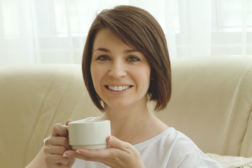 Young woman with cup portrait indoor