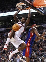 Raptors Johnson goes up for a slam dunk over Pistons Wilcox during their NBA basketball game in Toronto
