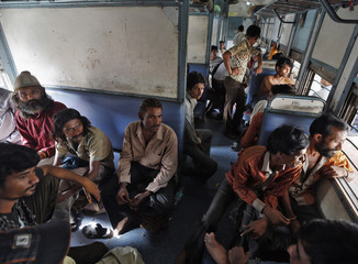 Released Indian fishermen sit inside train coach as they head home, after they were released by Pakistan, at a railway station in Ahmedabad