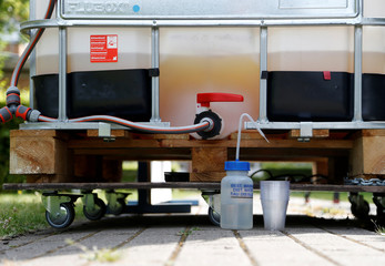 A tank with some 200 liters of urine is seen as part of a machine that turns urine into drinkable water and fertilizer using solar energy, at the University of Ghent