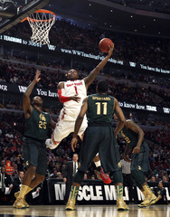 Buckeyes forward Thomas shoots over Spartans forward Nix and Appling during the first half of their NCAA men's college basketball game at the 2013 Big 10 tournament in Chicago
